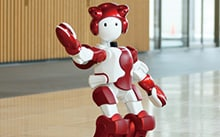 Diverse application technologies to produce EMIEW, a robot supportive to people